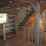 Hand hewn barn beams used in restoration of log home