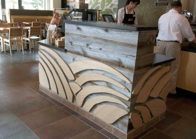 Reclaimed grey barn wood used ad retail counter