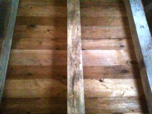 Reclaimed nautical wood brownboard ceiling example