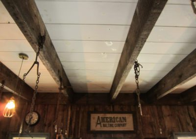 Example of reclaimed joists used on a beadboard ceiling