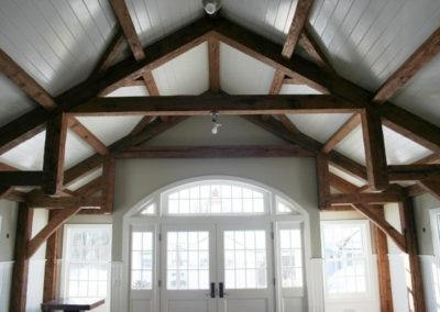 Examples of reclaimed hand-hewn beams in use